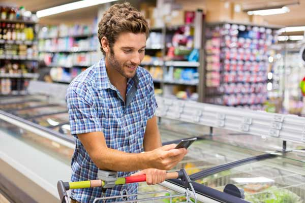 man-on-phone-grocery-store